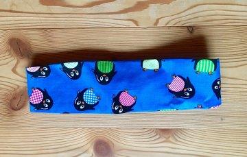 Flottes Haarband in blau mit bunten Pinguinen für Mädchen - Handarbeit kaufen