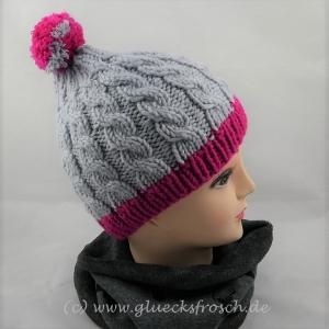 Graue Mütze mit Zopfmuster und rosa Rand - Handarbeit kaufen