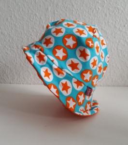 Jersey Sonnenhut für Kinder und Babys zum Wenden in türkis und orange mit Sternen
