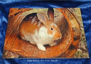 Holz Puzzle mit süßen Hasen