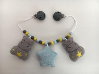 Kinderwagenkette mit süßen Nilpferden und Stern