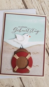 Geburtstagskarte mit Meeresblick - natürlich auch einem Rettungsring - gerne auch mit Zahl im Ring individualisierbar