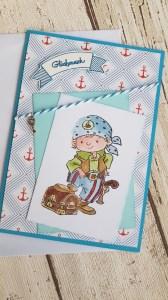 Grußkarte/Glückwunschkarte mit einem Pirat und einer Schatztruhe
