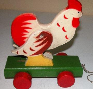 Holz-Huhn zum hinterher ziehen,das Huhn bewegt sich beim ziehen,Wackelhuhn,beide Flügel wurden neu verdübelt,Kinderspielzeug aus den 50er Jahren,guter Zustand aber mit Gebrauchsspu - Handarbeit kaufen