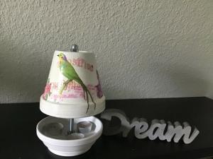 Teelichtofen Teelichtkamin  für Balkon und Terrasse  ,inkl 3 Teelichter  - Vogel