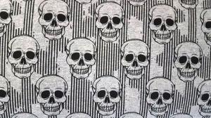 French Terry Sweat Skulls schwarze Totenköpfe auf graumeliert 1,50m Breite - Handarbeit kaufen