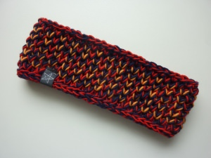 Stirnband in dunkelblau rot orange aus Schurwolle handgestrickt