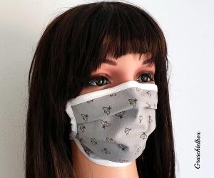 Mund- und Nasenmaske, 2-lagig aus  Baumwolle zum Binden mit Nasenbügel - Bienchen
