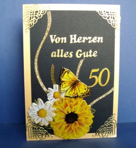 Geburtstagskarte zum 50 für eine Frau mit Blume und Schmetterling