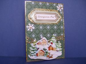 Weihnachtskarte in grün mit einer Winterlandschaft