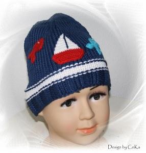Maritime, handgestrickte Kindermütze in dunkelblau mit Häkelapplikationen in 100 % Baumwolle