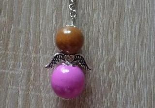 Handgefertigter Schlüsselanhänger mit Metallflügeln - braun-pink - Handarbeit kaufen