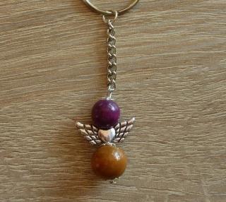 Handgefertigter Schlüsselanhänger mit Metallflügeln - lila-braun - Handarbeit kaufen