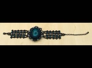 Armband breit aus Rocailles mit großer Glasperle; petrol-schwarz