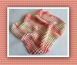 Babydecke zum Kuscheln, mit aufwendigem Muster gehäkelt, gelb/orange/rot - Handarbeit kaufen
