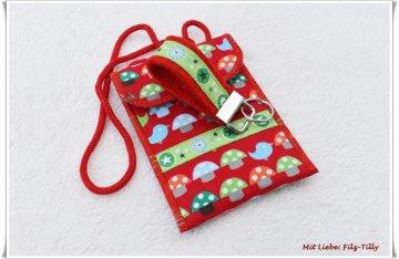 Set aus Brustbeutel & Schlüsselanhänger / Glückspilz / bunt auf rot