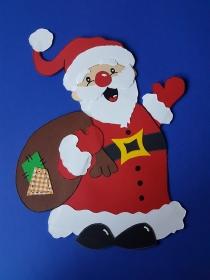 handgefertigtes Fensterbild aus Tonkarton: großer Weihnachtsmann / Nikolaus mit Sack
