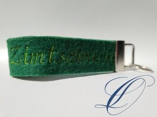 mopsiger Schlüsselanhänger Zimtschnecke grün