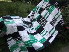 grüne Patchworkdecke