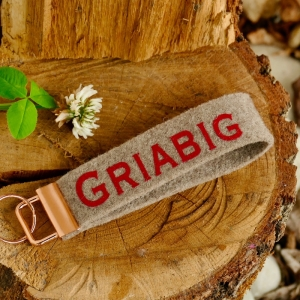 Schlüsselanhänger, Schlüsselband aus Wollfilz mit Aufschrift 'Griabig', Mitbringsel, Bayerischer Schlüsselanhänger - Handarbeit kaufen