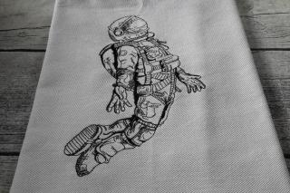 Geschirrtuch ägytische Baumwolle bestickt mit einem Astronauten.