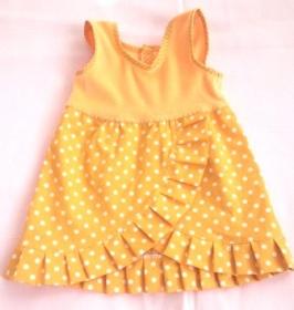 Sommerkleid  für Puppen in gelb mit weißen Punkten für Größe von 50 bis 55 cm Länge