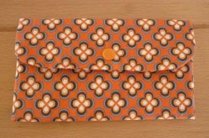 Täschchen bzw. kleines Portemonnaie aus Baumwollstoff in orange mit  Blumenmuster genäht kaufen