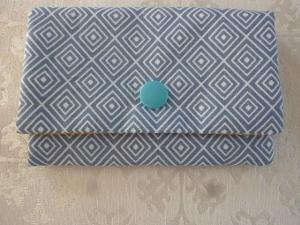 Täschchen bzw. kleines Portemonnaie aus Baumwollstoff mit graphischem Muster in gelb und blau genäht kaufen  - Handarbeit kaufen