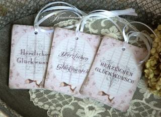 9-er Set Geschenkanhänger / Papieranhänger mit Glückwunsch Spruch & kleiner Schleife in feinm Rosa.