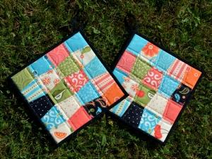 Patchwork-Topflappen mit bunten Trapezen, warme Töne der Stoffserie Sassy - Handarbeit kaufen