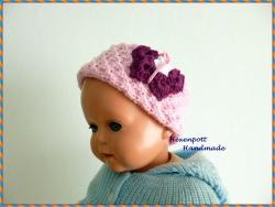 Stirnband für Kinder handgestrickt rosa mit Schmetterling