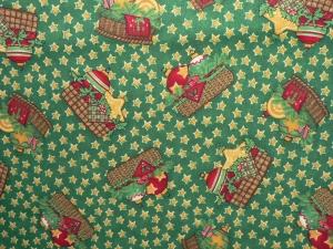 Baumwollstoff Weihnachtsmotive auf grünem Grund  - Handarbeit kaufen