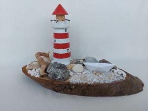 maritime Tischdeko auf einer Astscheibe mit Leuchtturm kaufen - Handarbeit kaufen
