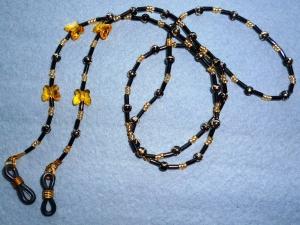 Handgefädelte Brillenkette aus Glasperlenmix in schwarz-gold - Geschenkidee