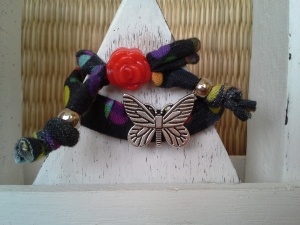 Armband ☀ Schmetterling ☀, Wickelarmband aus Stoffband mit Schiebeperlen - Handarbeit kaufen