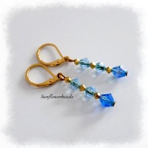 Ohrringe mit Glasschliffperlen blau gold und Edelstahlbrisuren gold - Handarbeit kaufen