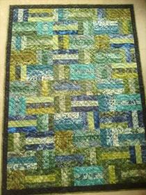 Quiltdecke  aus Batikstoffen -  handgequiltet -  Einzelstück - Handarbeit kaufen